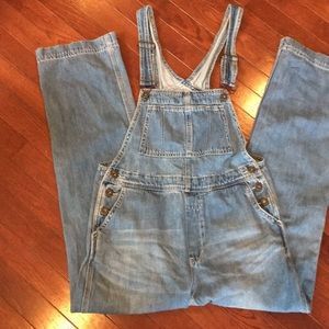 Free People denim jean bib overalls.